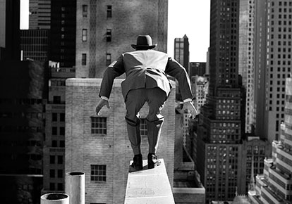 Alan leaping from 515 Madison Avenue, New York City, 1999